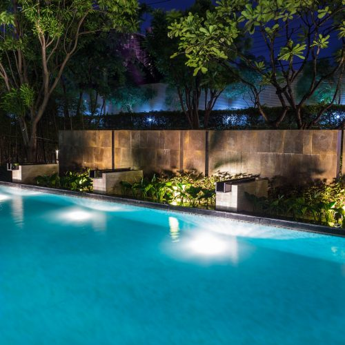 Pool,Lighting,In,Backyard,At,Night,For,Family,Lifestyle,And